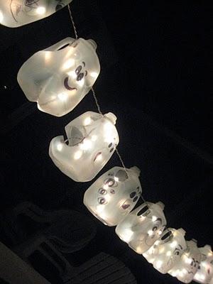 Hanging Lit Halloween Milk Jugs