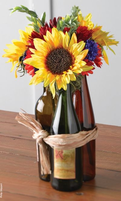 50th birthday party decorations for Wine bottles decorated with flowers